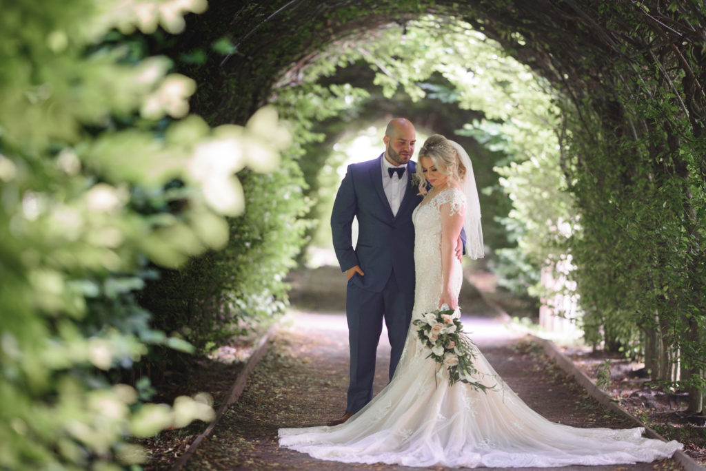 Bride and groom in natural arch