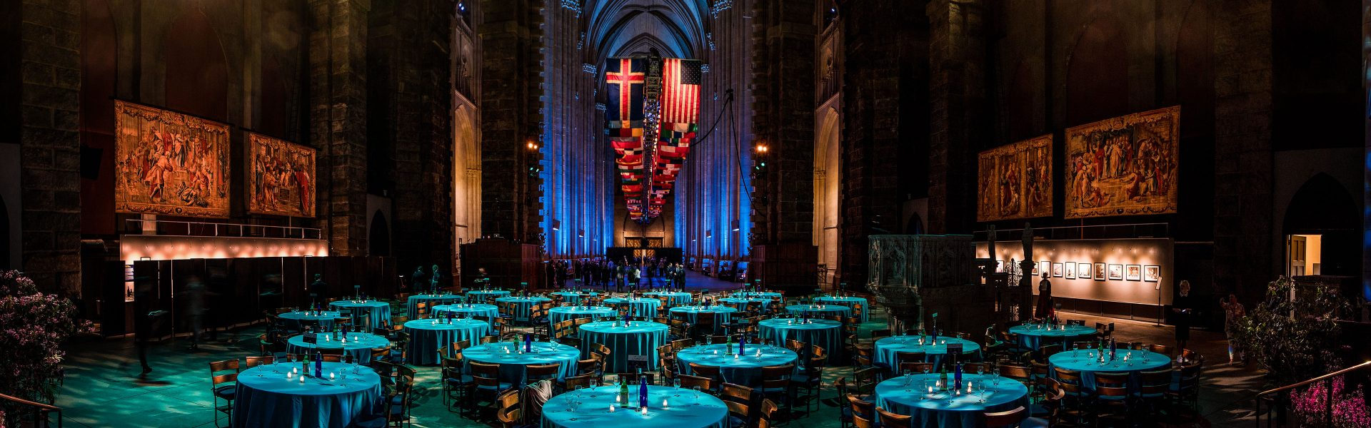 Indoor catered social event with blue lighting